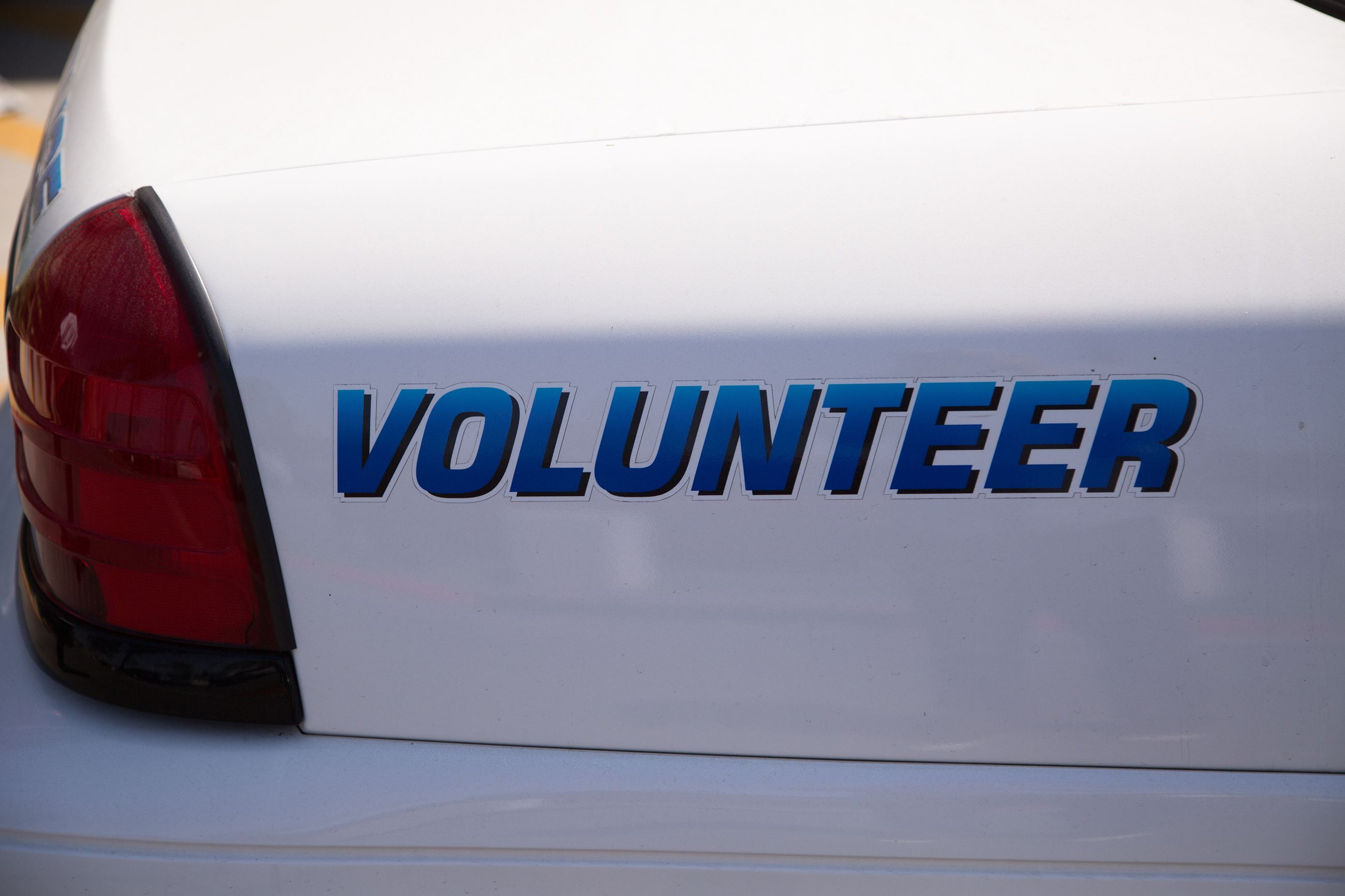 Back of Police Car that reads volunteer