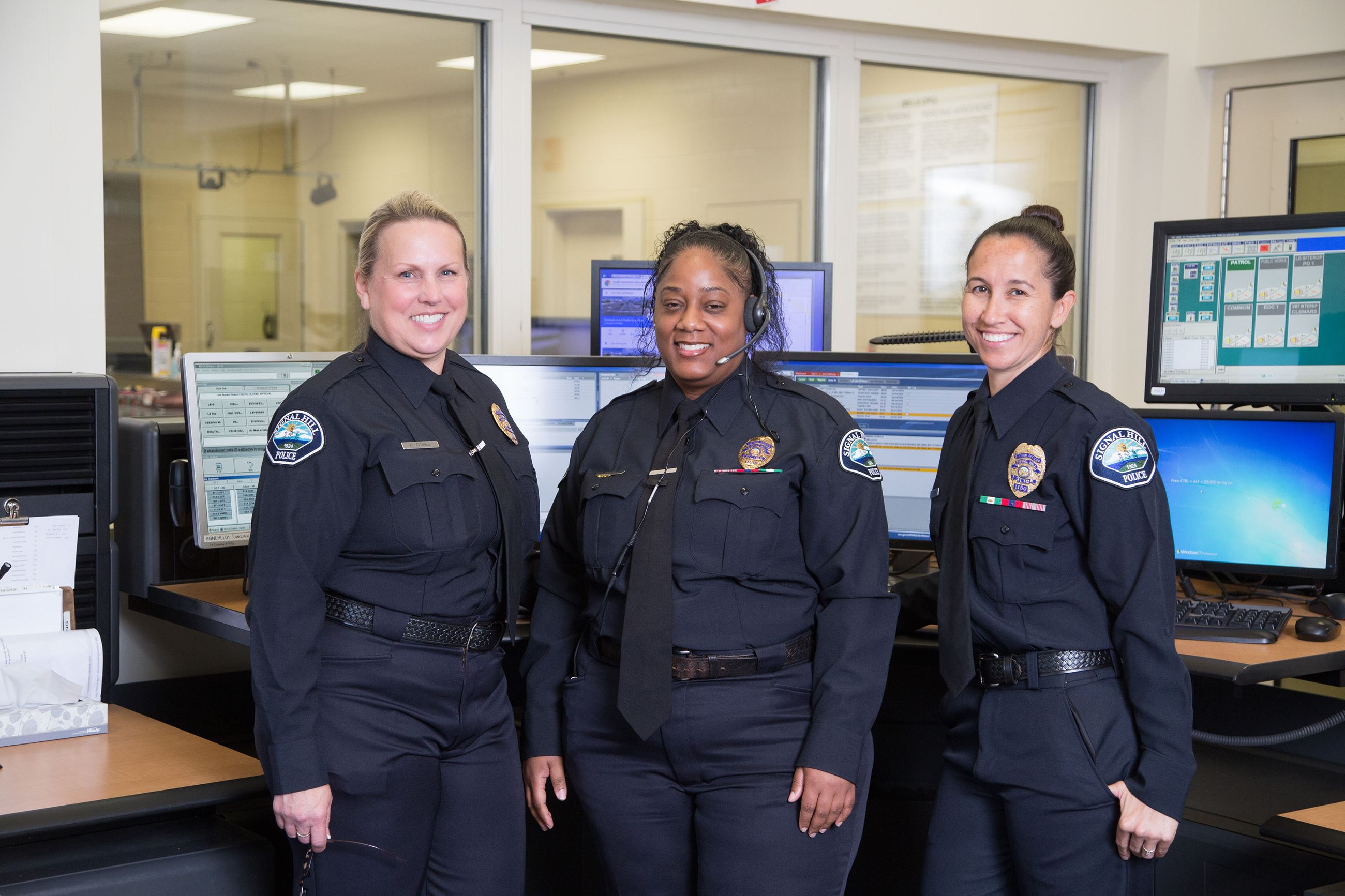 Dispatchers in front of dispatch desk